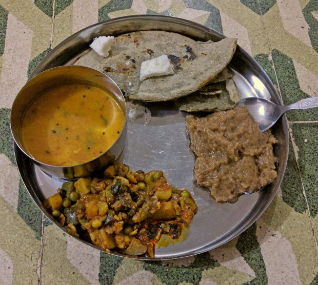 A typical Kutch village dinner of rotla, dal, sabzi and sheera